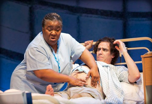 Midwife Joyce (Llewella Gideon) and Ed (Stephen Mangan) (C) Royal Court Theatre